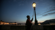 Meet the Lamplighter on the Charles Bridge